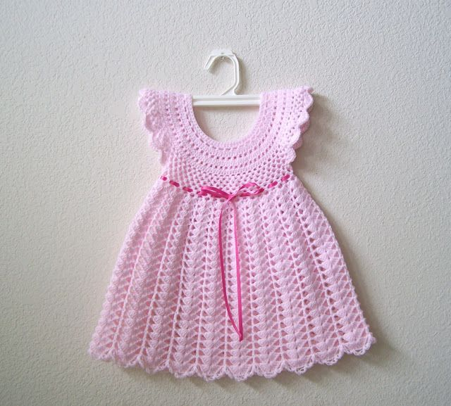 Dirndl skirt is joined to the bodice by a welt seam and tie ends coming from the side seams form a bow in back. lace or self-ruffle bands the yoke. panties with elastic at legs and waist.
